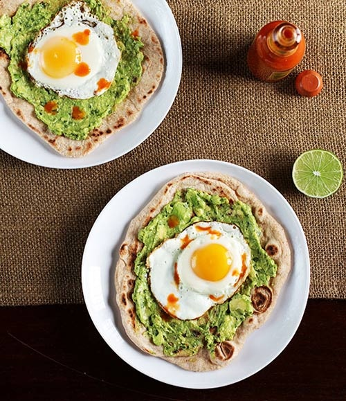 or pita bread, mashed avocado and a fried egg or two. top w/ hot sauce ...