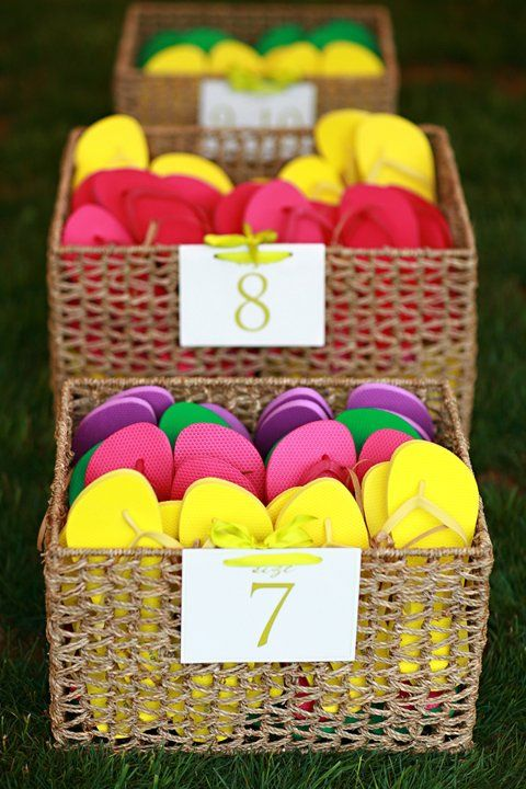 A colorful stash of flip-flops so your guests can dance into the night. #wedding (Photo by: Lynne Brubaker)
