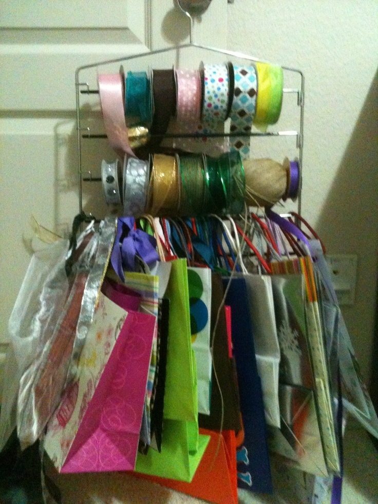 Stole the ribbon idea and then decided I could hang my gift bags on the bottom. So much easier to see what I have this way...and reassures me I do not ever need to buy another gift bag :) It is hanging in my office closet.