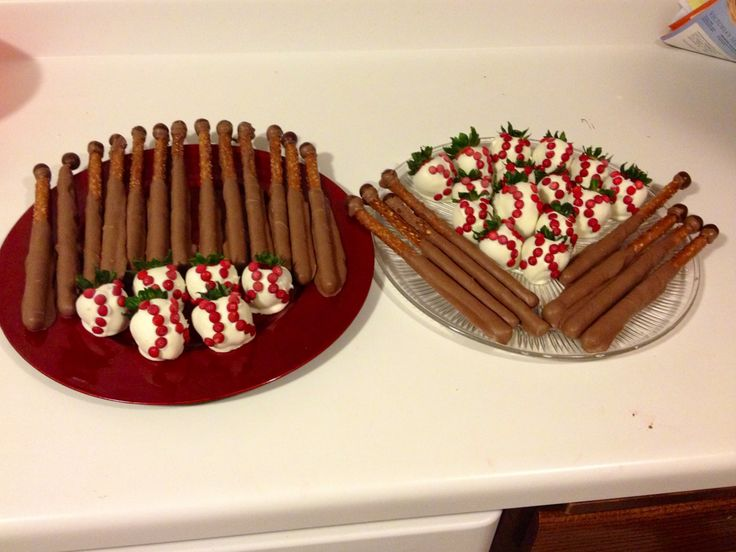 Baseball themes party! White almond bark covered strawberries with red ...