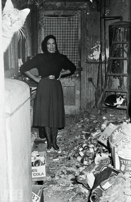 "The original hoarders  1972  ""Little Edie"" from Grey Gardens poses in her house filled with garbage."