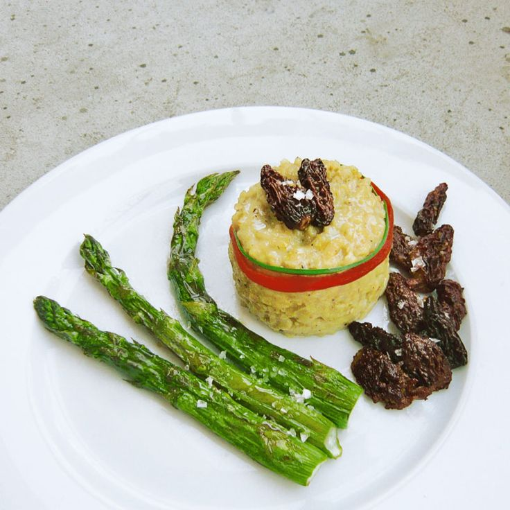 Lemon risotto with sautéed morels and grilled asparagus