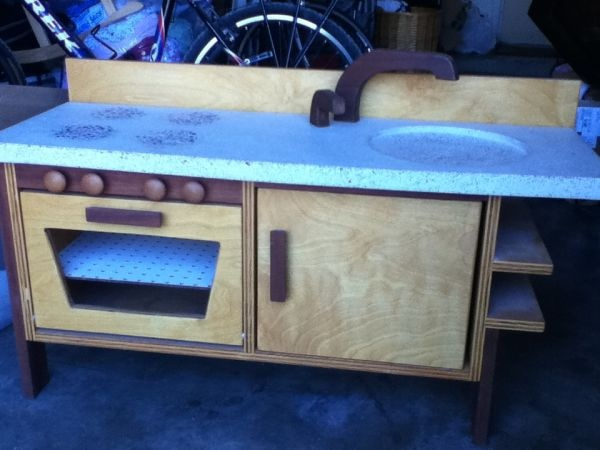 love this play kitchen made by an austin artist