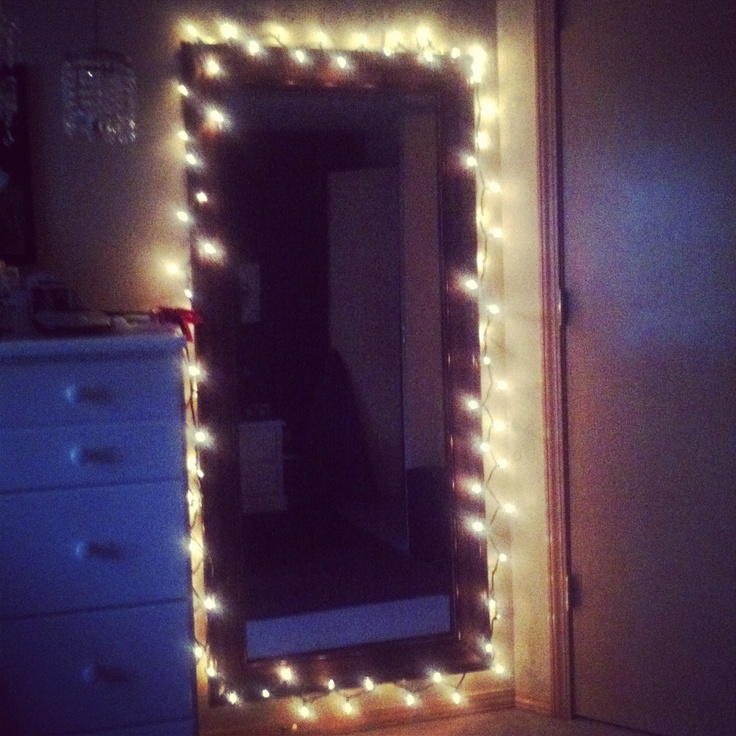 put simple white christmas lights around my mirror gives
