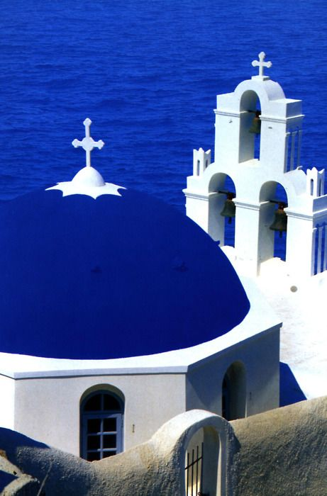 what a gorgeous shade of blue, the roof and the sea