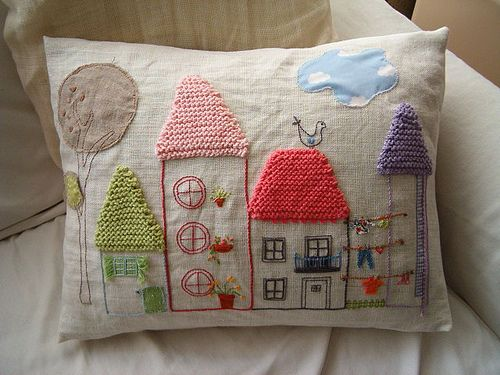 I love this! Embroidered houses with crocheted roofs.