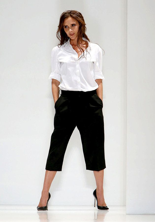 Victoria Beckhams Culottes and cool white shirt. Love this look.