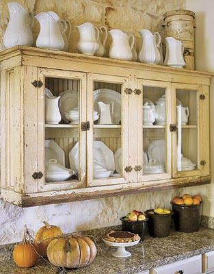 love this cabinet with the white ironstone