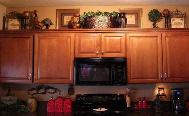 Ideas for decorating ontop of kitchen cabinets home Design ideas for above kitchen cabinets
