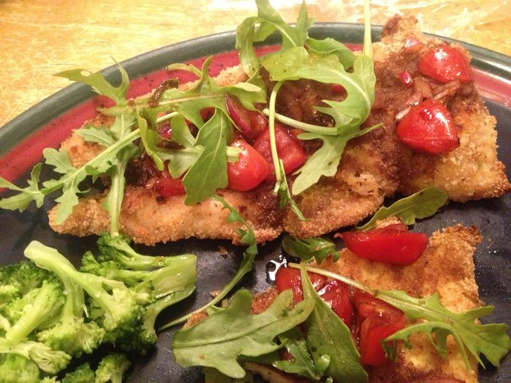baked Chicken Milanese with baby arugula, red onions, cherry tomatoes ...