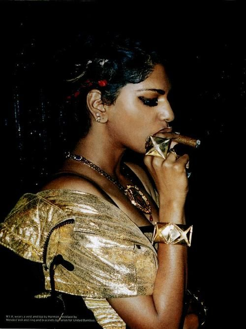 M.I.A. smoking a cigarette (or weed)