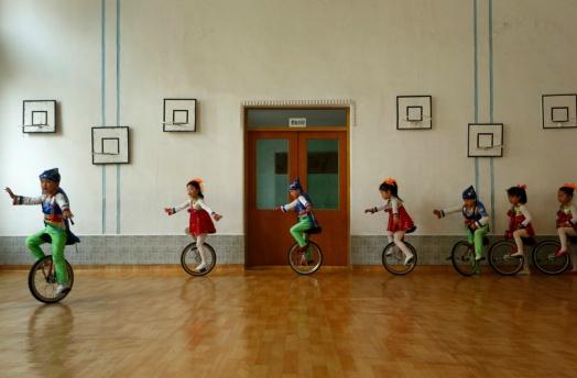 North Korean children riding unicycles in kindergarten. Photo by Vincent Yu/AP.