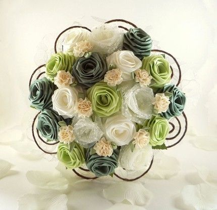 Origami bouquets. The lace flowers added in are a nice touch especially since you are considering burlap and lace.