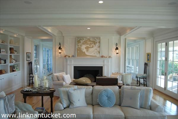 nantucket style the cottage mix i love the art above the fireplace