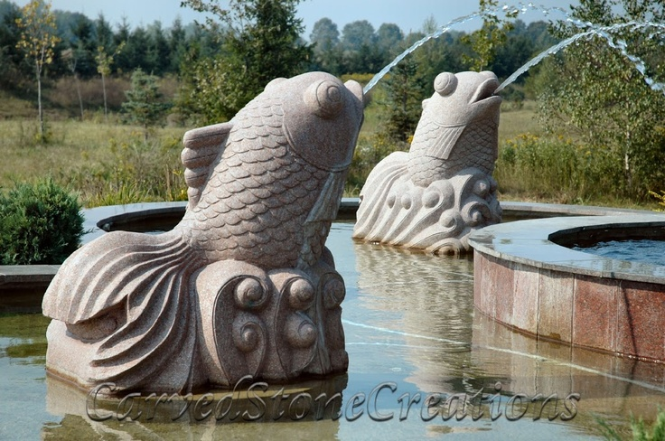 Spitter statues like these granite fish by carved stone for Outdoor pool sculptures