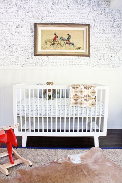 We adore a white nursery with a pop of color. #whitenursery