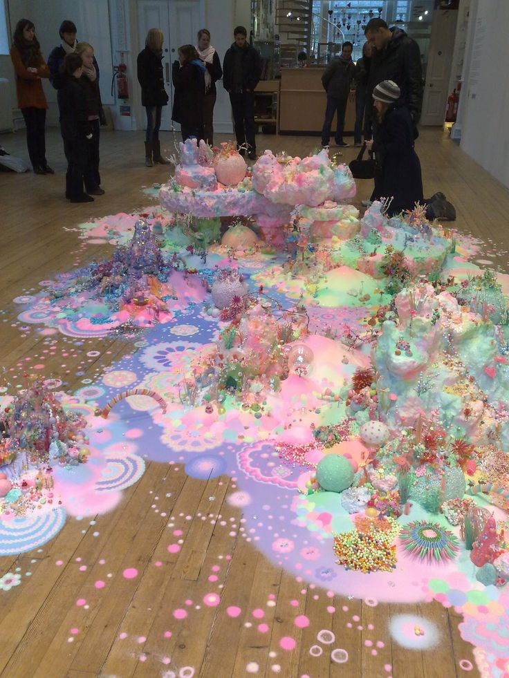 @Enid Hwang I'll see  your 'cotton candy dissolving into a cocktail' and raise you the candyraver equivalent of the Monty Python 'just one more thin wafer' scene.    Credit: Nicole Andrijevic & Tanya Schultz - Sweet, Sweet Galaxy (2011) - sugar, pigment, polystyrene, wax, modeling clay, paper, plastic, found objects, wire, beads, glitter, and sound