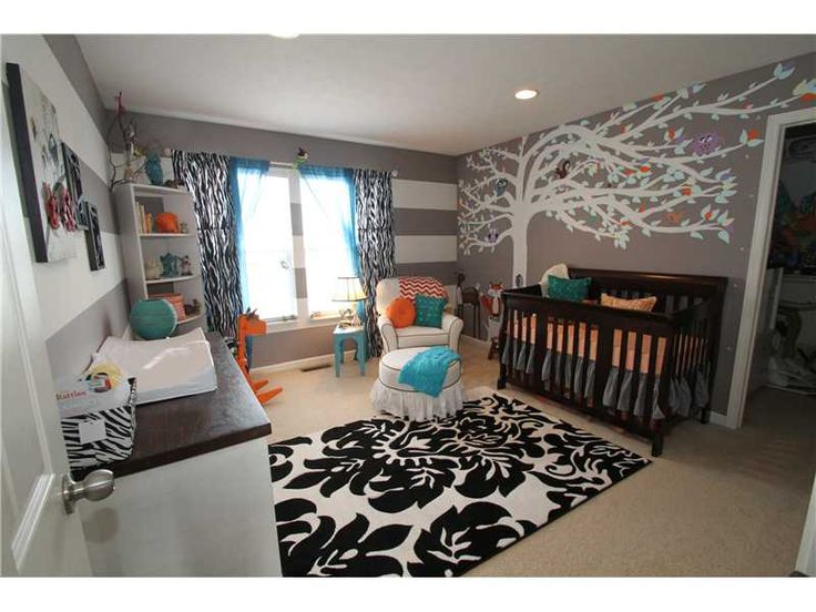 We love the gray striped accent wall in this forest-themed nursery! #nursery #nurserydecor