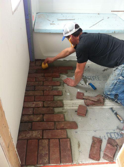 Brick bathroom floor finish materials pinterest for Brick tile bathroom designs