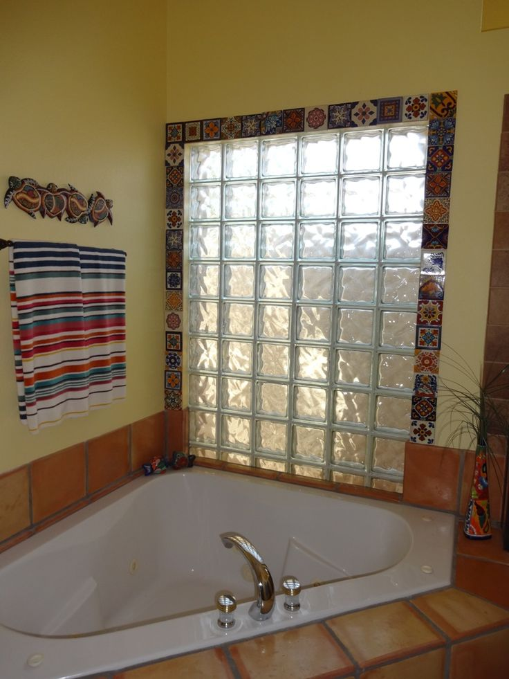 "Mexican tiles and some Command velcro strips create a ""framed"" bathroom window that can easily be removed in the future with no wall damage."