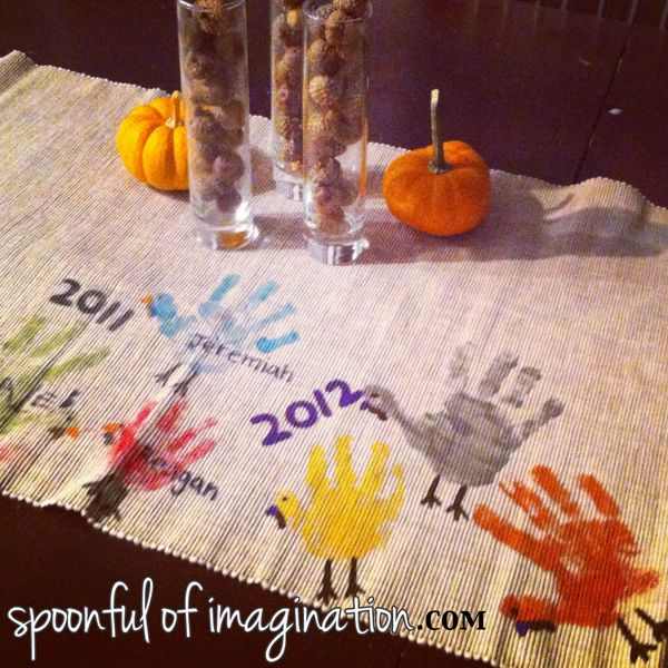"Thanksgiving Table Runner - Last year, I started a Thanksgiving table runner. I took an old creme table runner I had, and used my kids handprints to paint turkeys. This year we updated it with ""new turkeys"". I think it will be so fun to watch the handprints get bigger through the years."