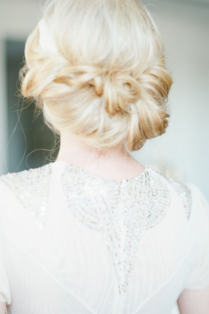 style me pretty | wedding hairstyle | low messy up-do | bride | wedding hair