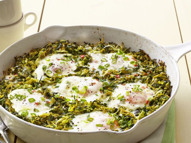 this crowd-pleasing recipe, baked eggs sit atop grated summer squash ...