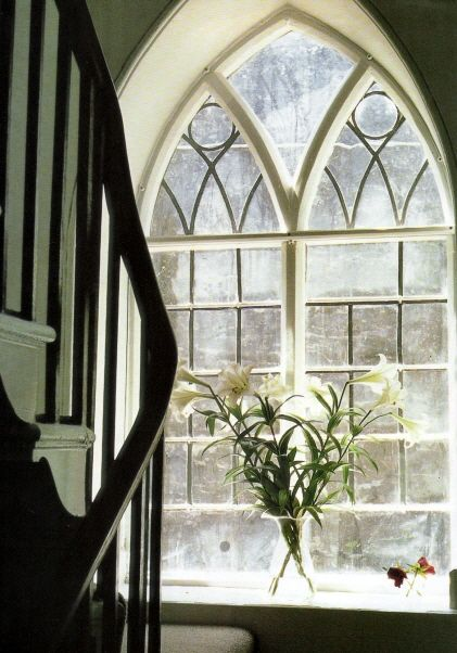 Gorgeous arched window.  Great bones make for a lovely home.