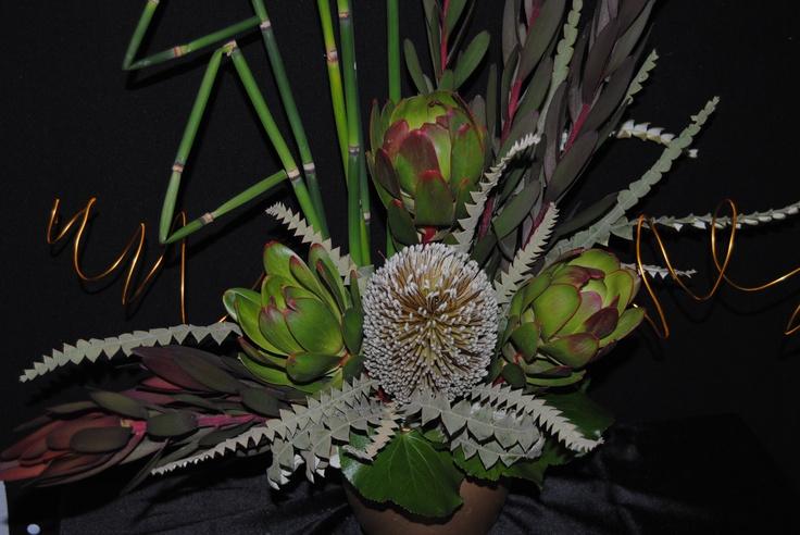Protea floral arrangement | Table centerpieces | Pinterest