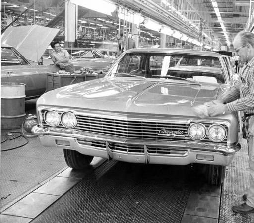 Interior view of two workers on the assembly line at the General Motors plant in Van Nuys, circa 1960. The General Motors assembly plant opened in 1947 and was one of the San Fernando Valley's first attempts to progress from agriculture into large industry. When in full production, the plant employed 3,500 workers and helped to expand industrial, commercial, and residential development. San Fernando Valley Historical Society. San Fernando Valley History Digital library.