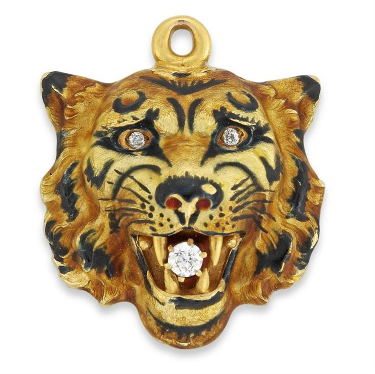 An American Art Nouveau enamel and diamond tiger head pendant, enamelled in Thompson's leaded opalescent enamel the tiger head laid with ric...