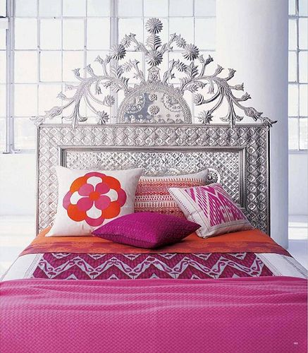 Ed Casamidy elaborate punched tin headboard paired with brightly colored bedding  (by Belledame73)