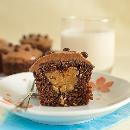 ... peanut butter filling topped with decadent chocolate ganache frosting