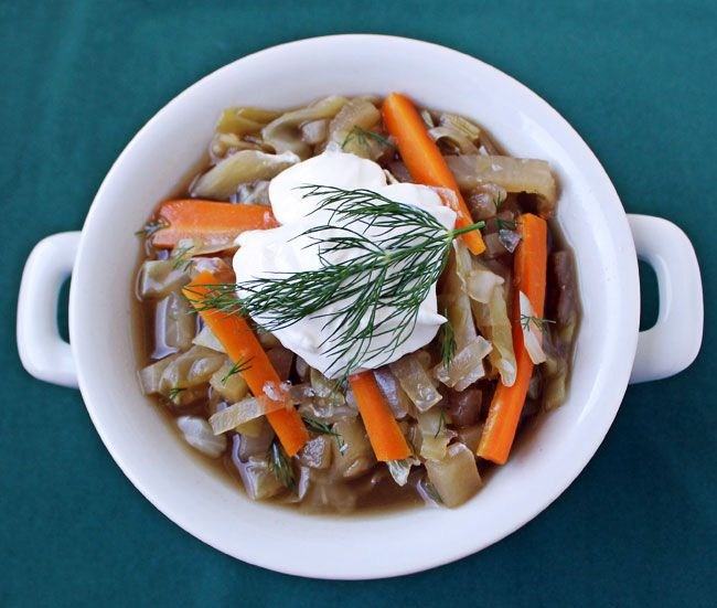 Russian Cabbage Soup has a savory broth, crunchy vegetables, a ...