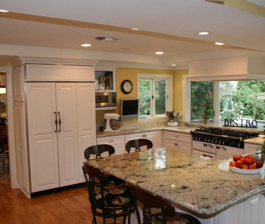 Traditional U shaped Yellow kitchen, white cabinets, $50,000  $