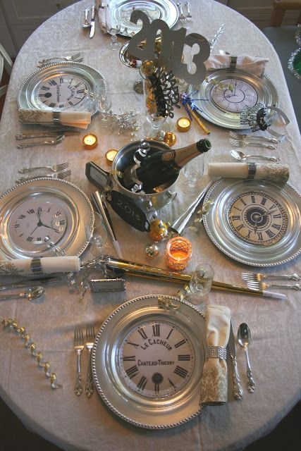 use clear glass plates with copies of clock faces underneath on top of silver chargers for a new year's eve table setting.