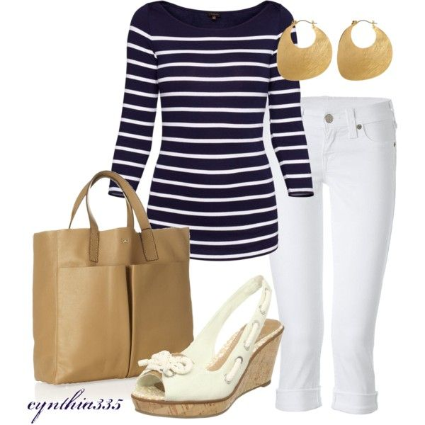 Navy blue striped shirt, white pants, gold earrings, white shoes