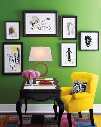 I like the a lot about this photo - the desk, photos, wall color, even the yellow chair is kinda cool!