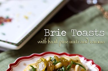 Brie Toasts with Basil, Pine Nuts and Golden Raisins