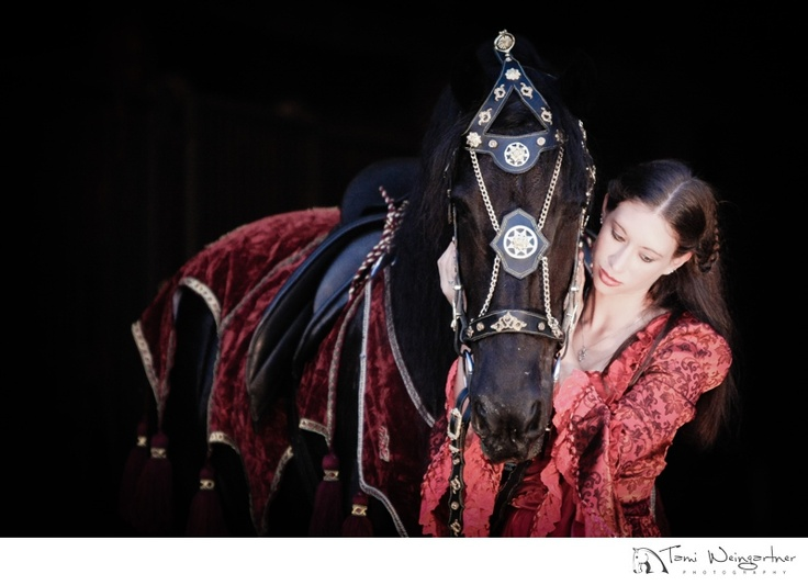 Gorgeous Friesian Horse with Girl in Native Costume