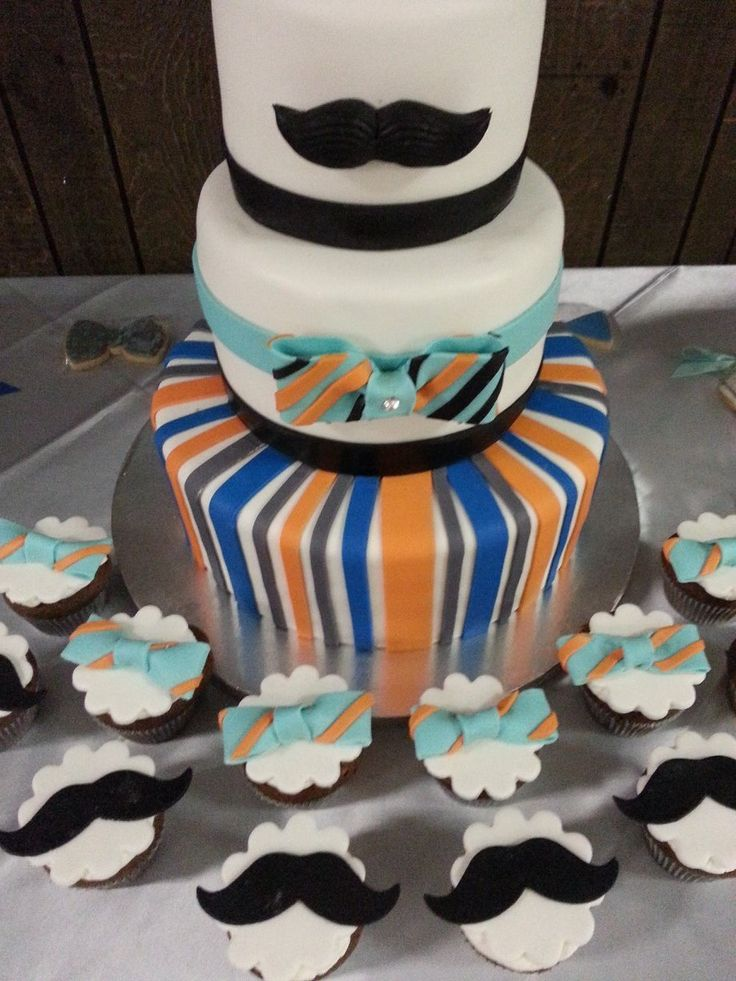 mustache and bow tie baby shower cake and cupcakes