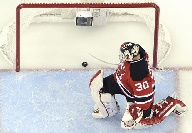 looks like a goal. Martin Brodeur sweeps away the puck from the net ...