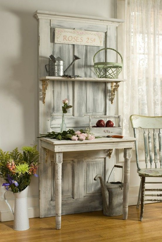 Use Salvaged Door -Then Attach half a table to it -And Add corbels & planks to create shelves !! Genius !