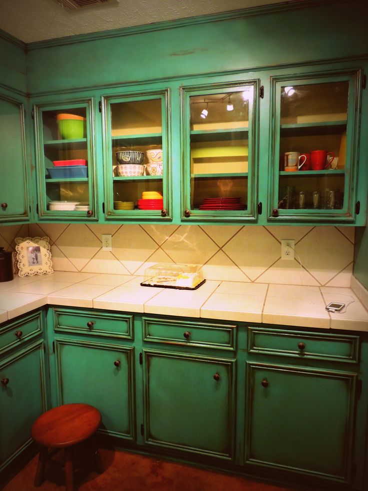 just showing off my antiqued turquoise cabinets i just did!