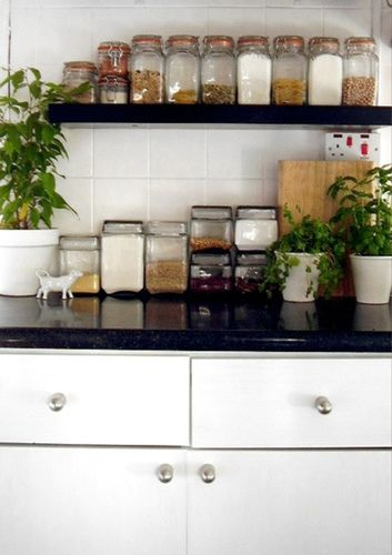 Great way to store spices and grains in a small kitchen:  in matching containers on a shelf hung above your counter. This would work in an apartment where counterspace is at a premium.