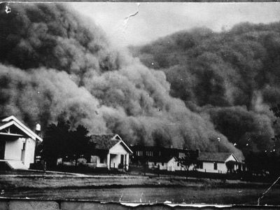 A giant dust storm blacks out the sky of Goodwell, Okla., during the Dust Bowl.  Dust storms plagued the U.S.  from 1931-1939.