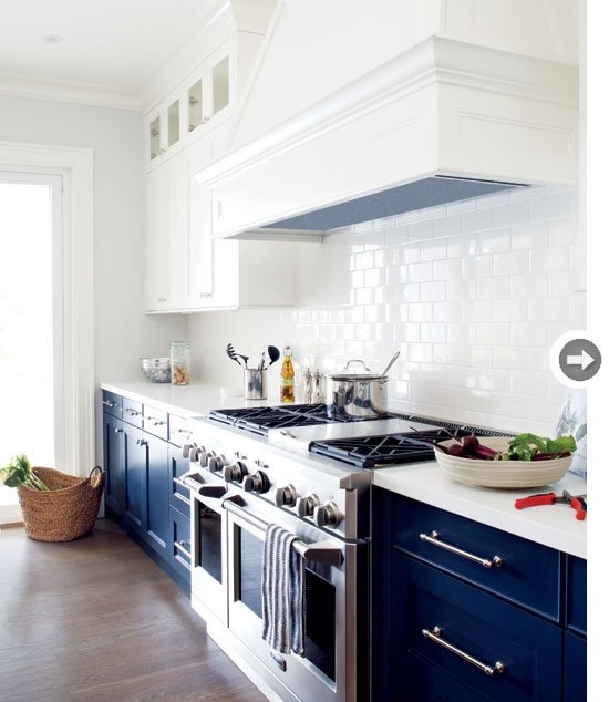 navy kitchen cabinets, white subway tile, white uppers love it