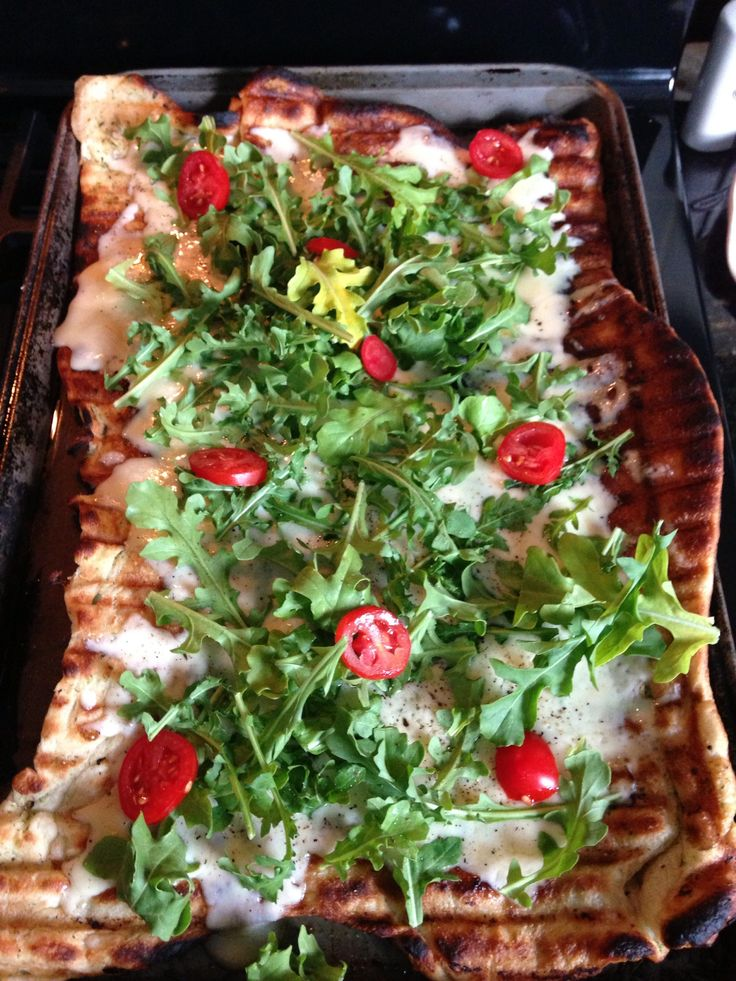 Grilled pizza with fontina and arugula and a few sliced grape tomatoes ...