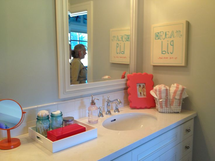 Turquoise and coral bathroom