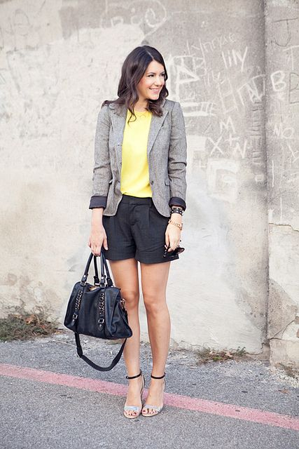 yellow blouse, tweed/gray blazer, and black.